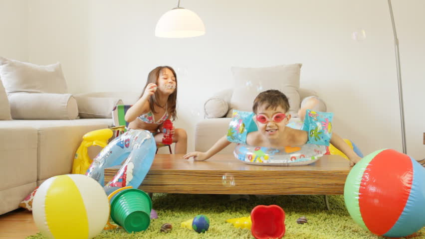 Kids playing in the living room, fantasize about they are on a beach.  | Shutterstock HD Video #3623798