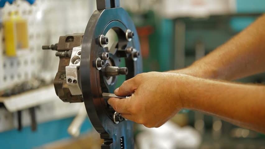 Auto mechanic is repairing fuel pump. Close-up. Original sound included.