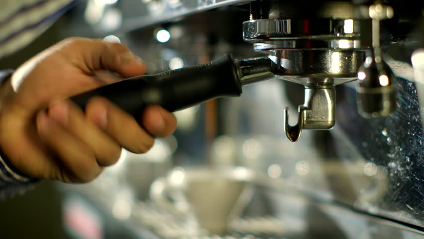 Barista makes two coffees in coffee bar