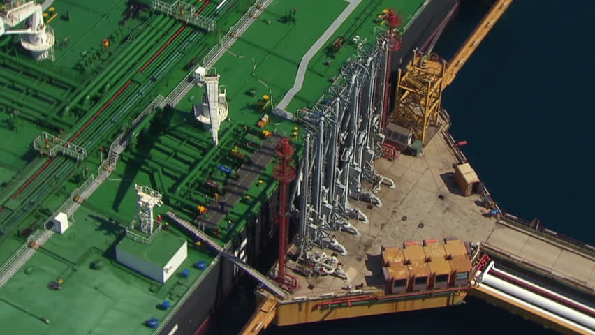 Aerial helicopter shot of a tanker with its mechanization in LNG terminal