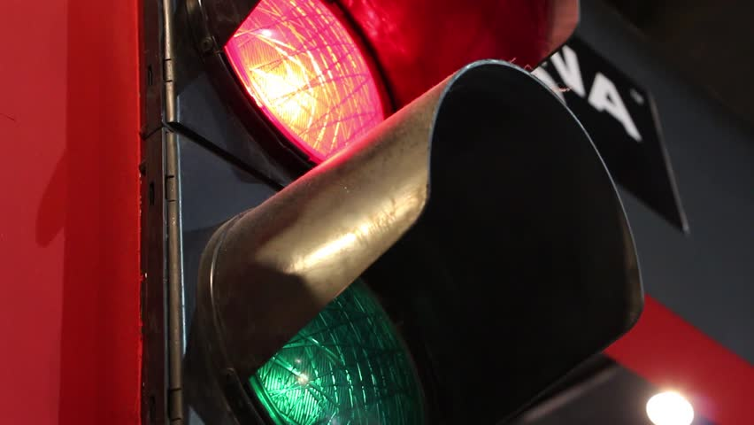 Green and Red bulbs blink in a traffic light