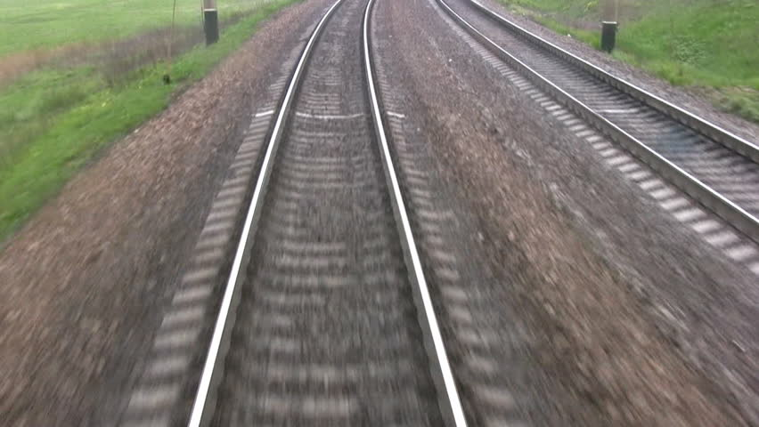 View from the last car of a train. Rails run away. Real sound