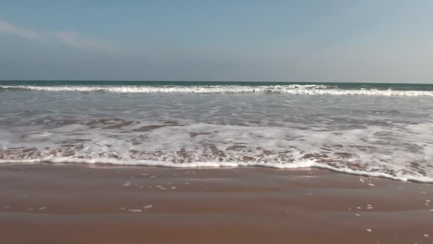 Ocean Waves and Beach: The waves from the sea of Bay of Bengal  come rushing to the coast in Chirala town of Andhra Pradesh, India.