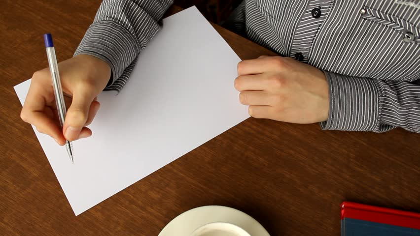 Human writing a formal letter in his office stock footage video man writes a letter on a white sheet of paper with a pen handwriting altavistaventures Images