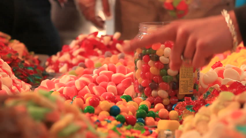 Finger pointing at jelly candies at a display | Shutterstock HD Video #3687671