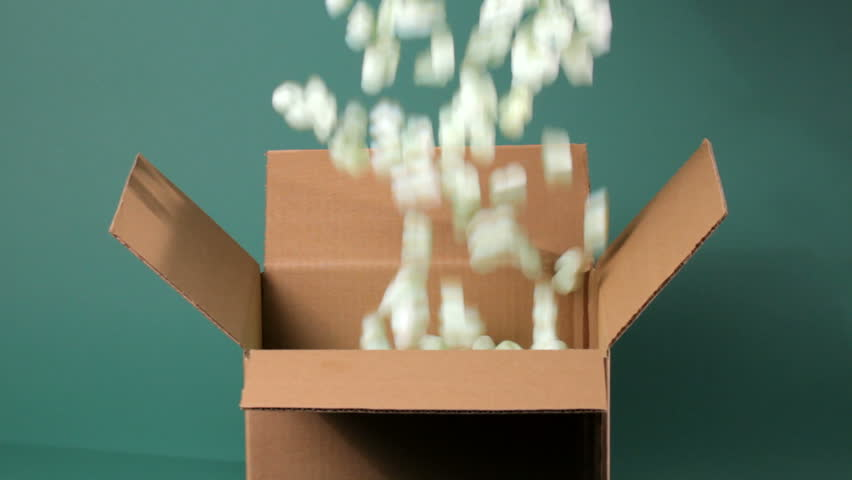 Green packing peanuts falling into brown corrugated box, shot in HD video