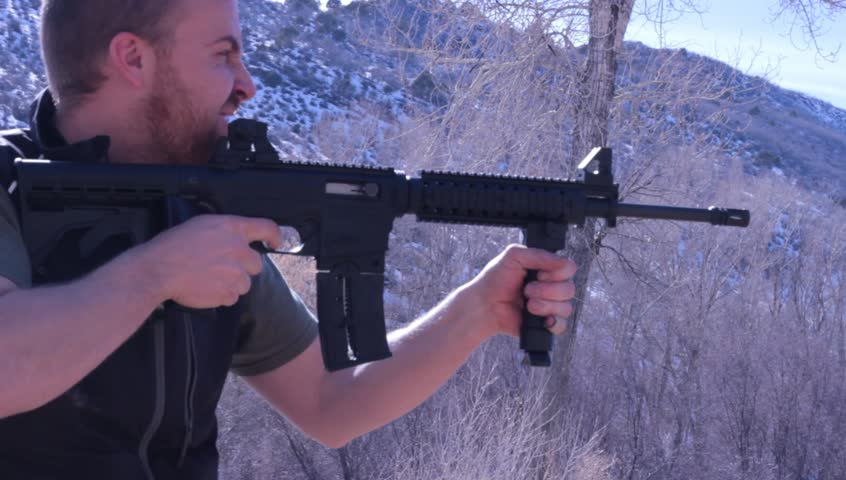 An black AR-15 Assault rifle, a semi-automatic weapon
