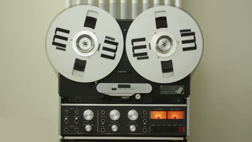Reel to reel tape playing on a tape machine, slow motion