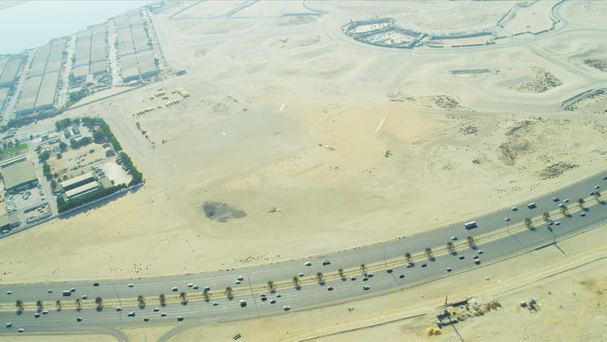 Old steam engine locomotive train with freight carriages moving on aerial view of modern desert dual lane carriageway development dubai uae middle east malvernweather Images