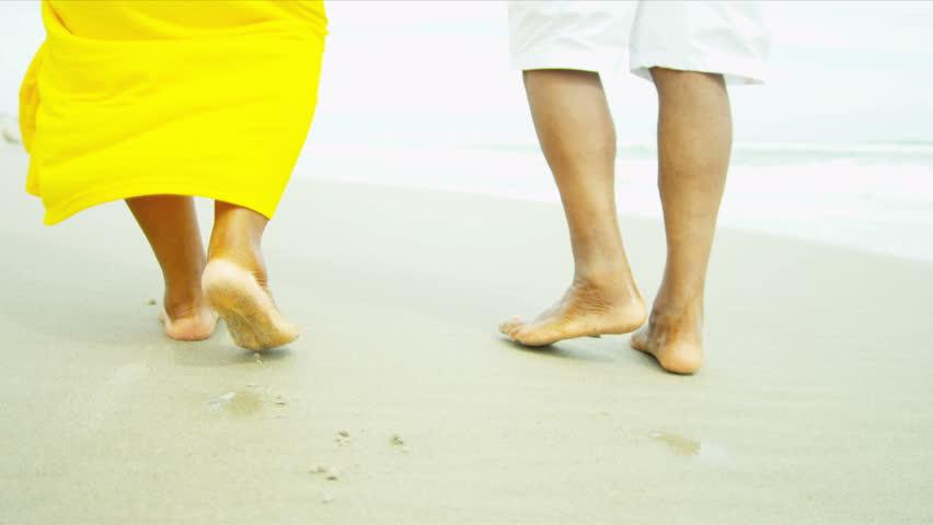 legs feet senior african american male female walking barefoot