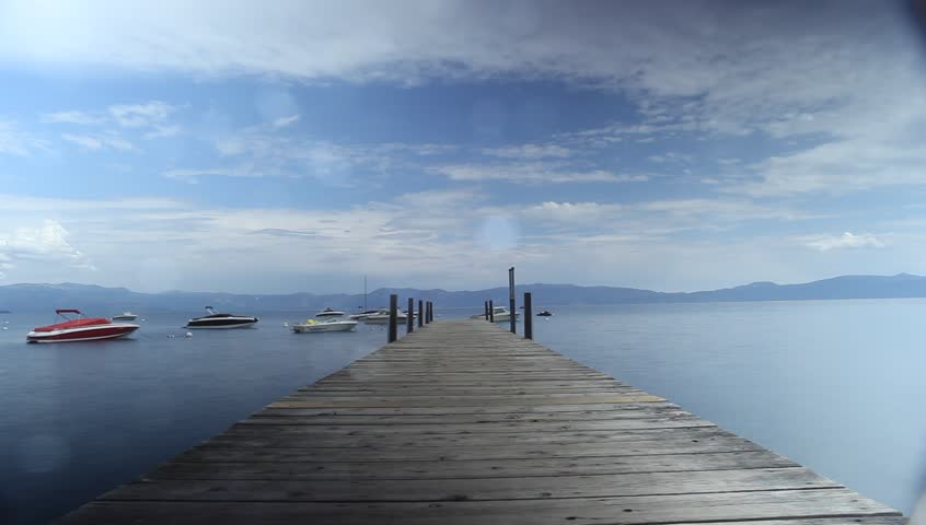 Time-lapse of boats dock by McKinney Bay Pier at Lake Tahoe.