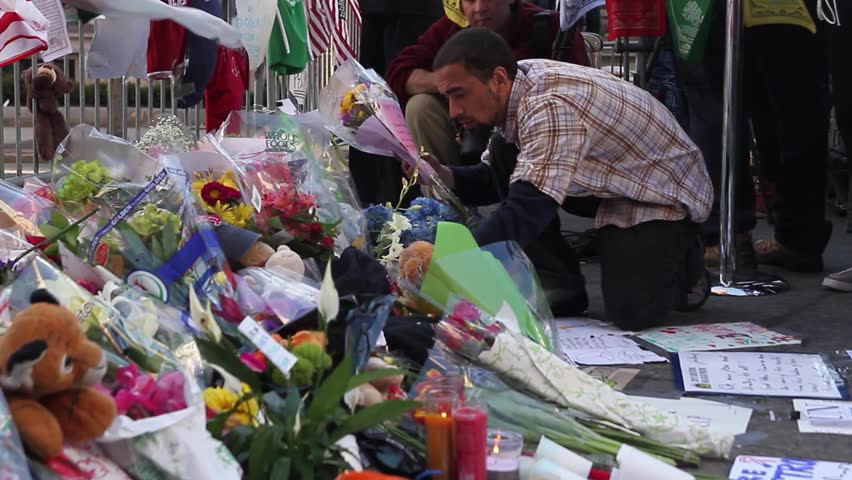 BOSTON, MA - APRIL 17: People gather around a makeshift memorial for the victims of the Boston marathon bombings on April 17, 2013 in Boston, MA.