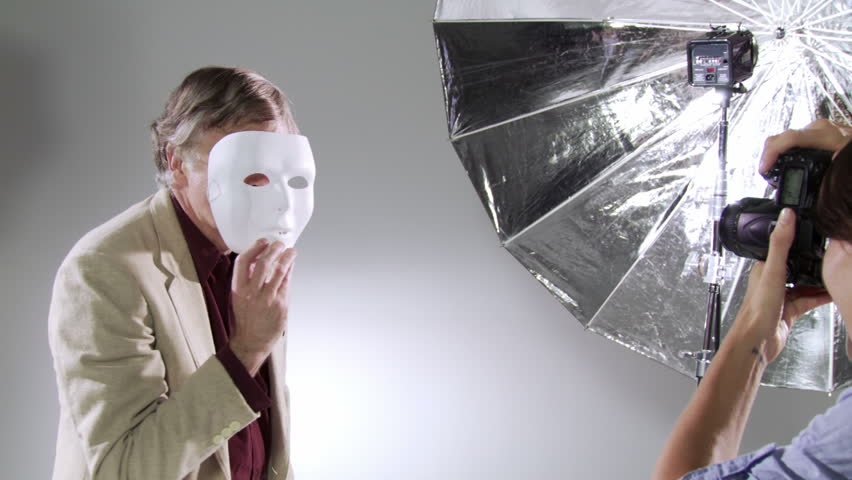 Photographer captures images of the actor/celebrity behind the mask. Edgy, hand-held camera in studio.