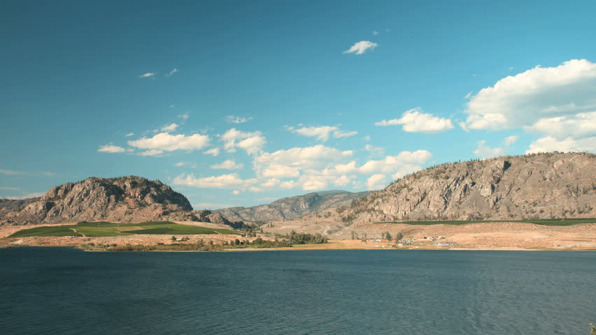 Osoyoos Lake Timelapse, British Columbia. Timelapse view of Osoyoos Lake and the hills and vineyards in the Southern Okanagan Valley. British Columbia, Canada.