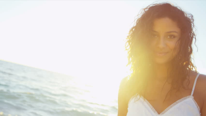 Portrait smiling girl in sundress enjoying being alone by ocean at sunset on beach vacation shot on RED EPIC