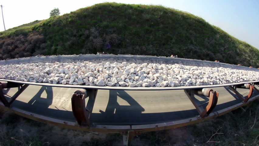 Fisheye of a long conveyor belt transporting stones to the manufacturing plant