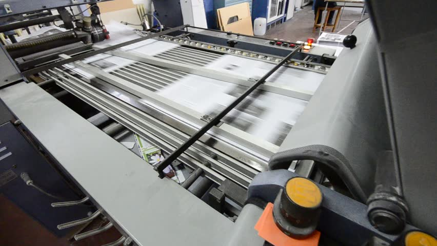 folding machine HD CRANE SHOOT folds printed offset sheet as part of newspaper