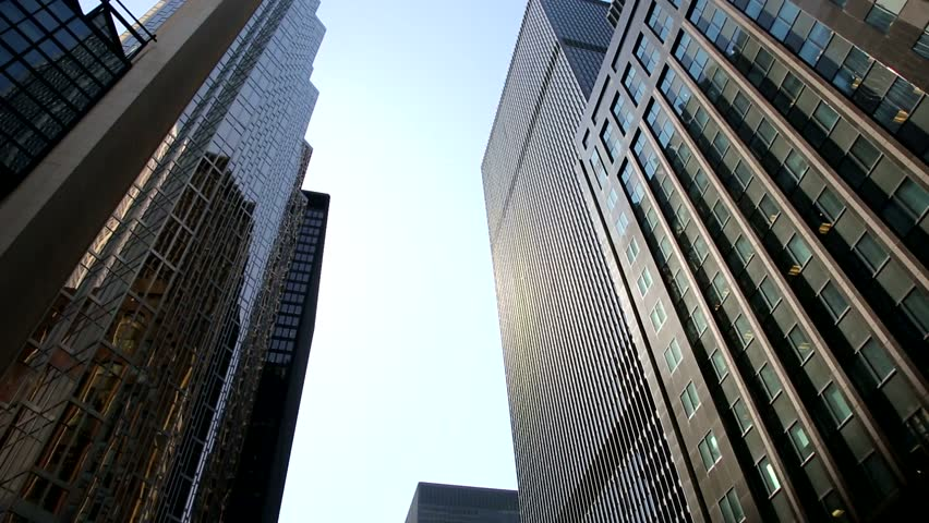 Towering skyscrapers in the heart of Toronto's financial district.  Rotating video of the high rise office buildings at the corner of Bay Street and Wellington Street West in Toronto, Canada.