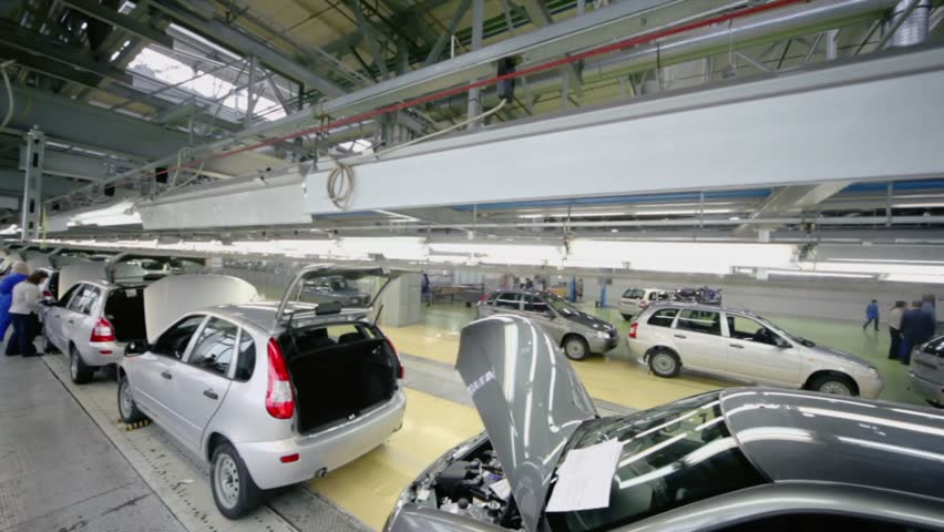 TOGLIATTI - SEP 30: New Lada Kalina cars stand on conveyor at factory VAZ, (shown in motion) on September 30, 2011 in Togliatti, Russia. AvtoVAZ Group made profit 29,2 billion rubles on result of 2012