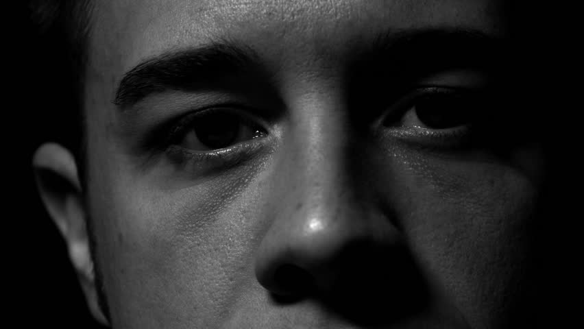 Man's eyes in black and white. Experimental lighting.