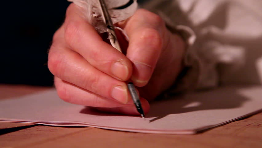man writes a letter with quill pen