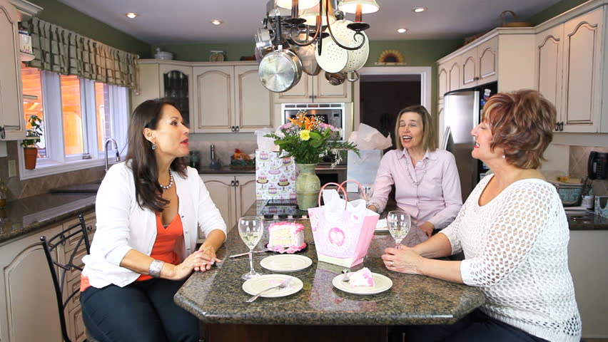 Three Mature Women Friends Celebrating A Birthday In A House Kitchen Party