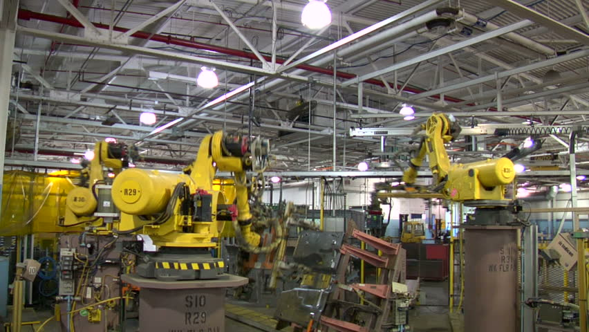 Robotic Arm Loads and Welds Car Part
