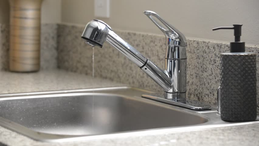 Stock Video Clip of Man turns off dripping kitchen sink faucet ...