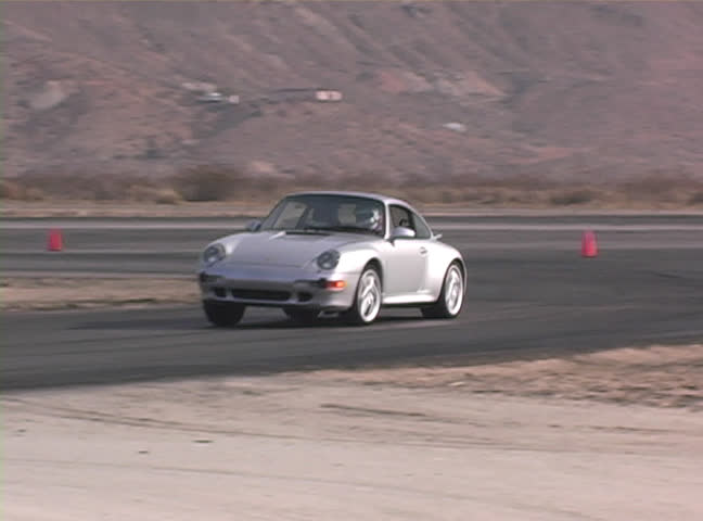 Cars Make Turn On Race Track Stock Footage Video - Sports cars makes