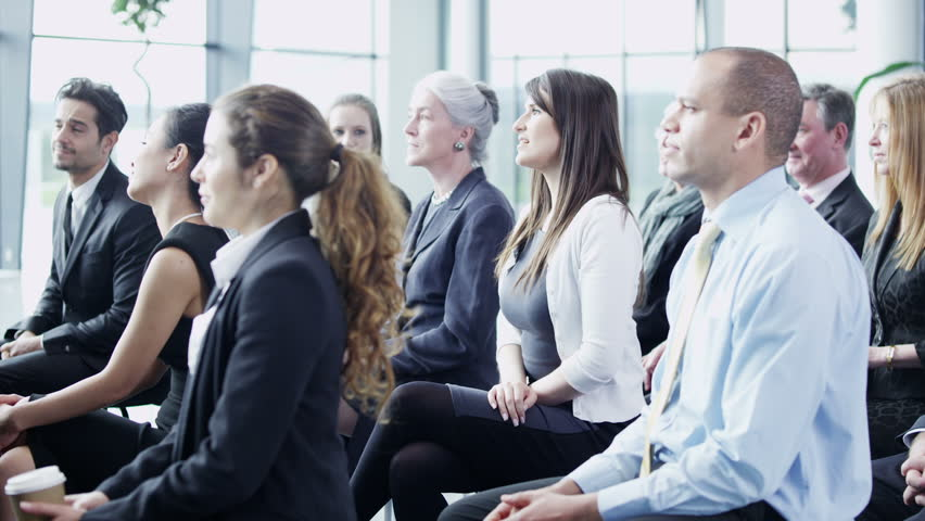 A multi ethnic group of business people of mixed ages are listening to a presentation at a business seminar and asking questions. In slow motion.  | Shutterstock HD Video #3895628