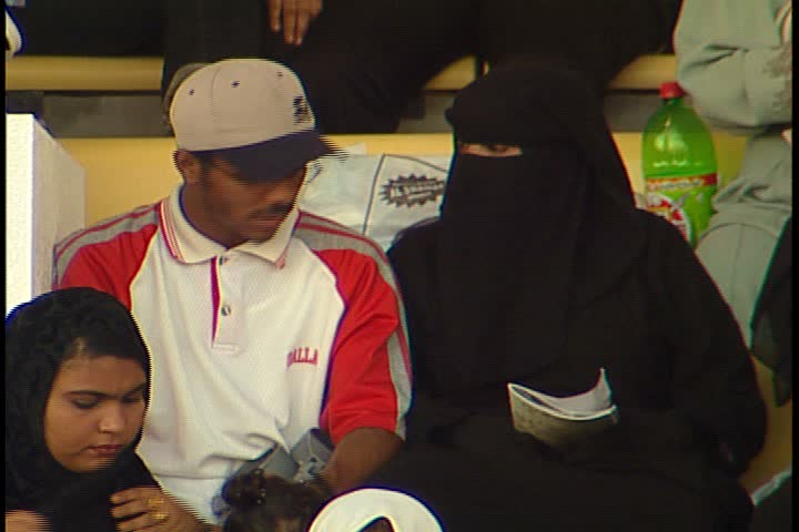 DUBAI - NOVEMBER 02, 2001: General views of Jebel Ali Race Course; MS couple sitting together in stands.