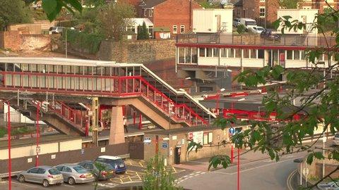 A modern footbridge crossing at a railway station.