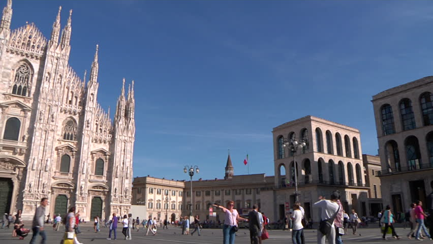 MILAN - CIRCA 2012 - A wide pan over the Piazza del Duomo. Duomo di Milano in the middle is the cathedral church of the city, the fifth largest cathedral in the world and the largest in Italy