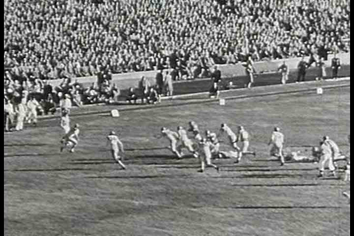 1950s - A high school or college football game from the 1950s.