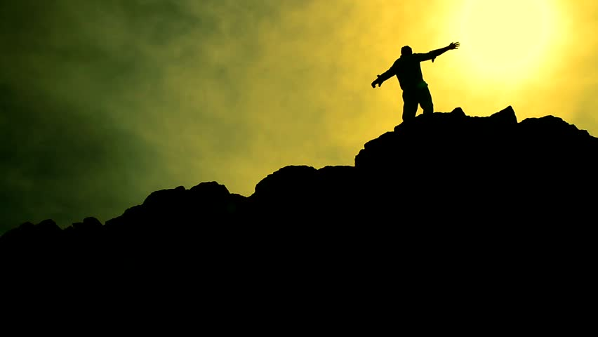 Man Climbing Rocks Lifting Hands in Worship Pose Color Enhanced Background HD | Shutterstock HD Video #3912068
