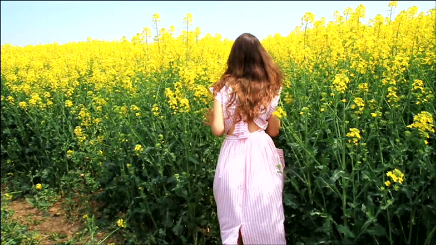 Female Model in Vintage Dress Running through Yellow Field Slow Motion HD #3913778