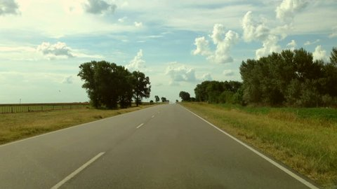Driving a Car on a Country Road - POV - Point of view front - windshield. Day.