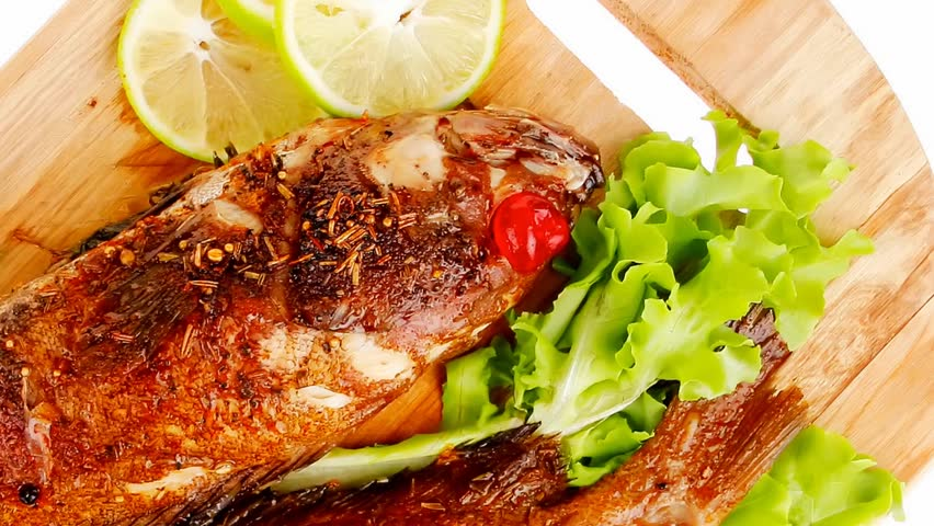 main portion of two grilled fish served on wooden plate 1920x1080 intro motion slow hidef hd