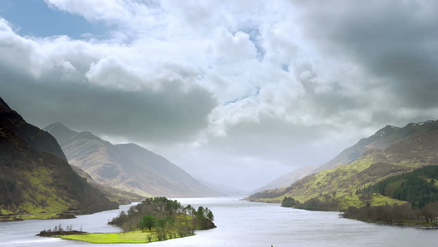 Time lapse video of Scottish highland scenery. Sunrays sweeping through the clouds.