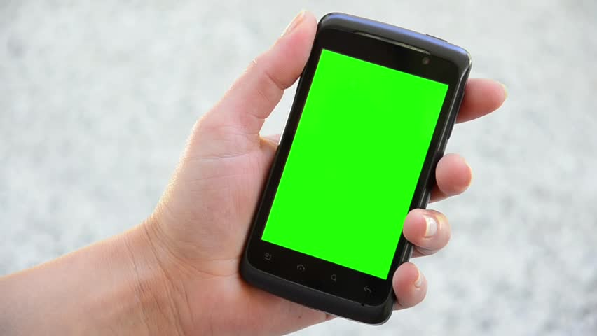 Holding Touchscreen Device, Close-up of female hands using a smart phone. chroma-key, green-screen