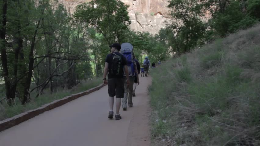 Tourists hiking through Zion National Park in Southern Utah | Shutterstock HD Video #3938408