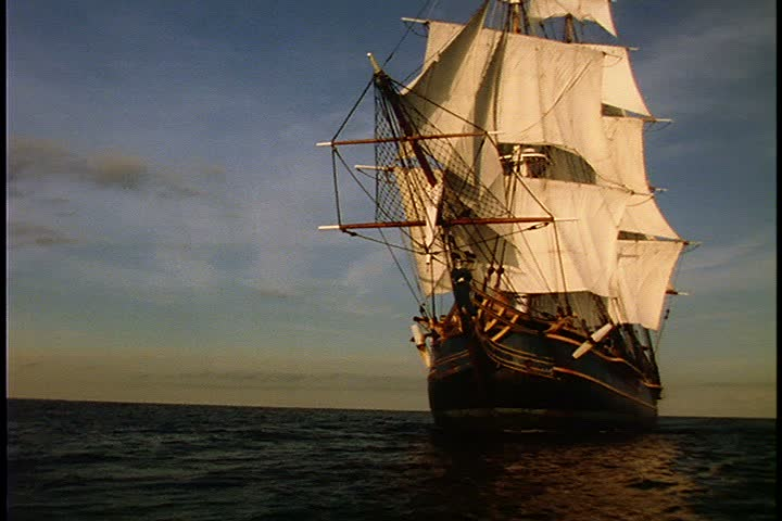 Historical reenactment of HMS Bounty ship on Rhode Island. MS HMS Bounty under full sail in bright sunlight as it turns to face screen left for full side view.