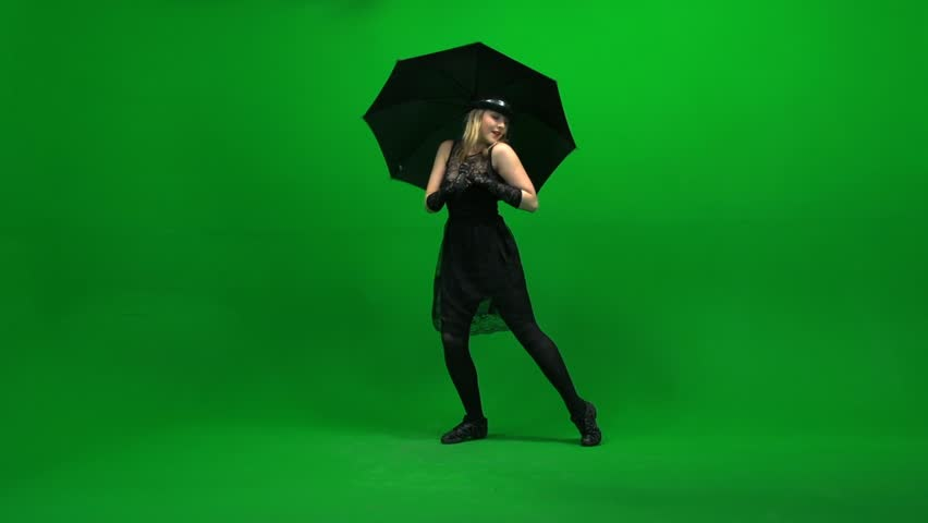 women dancing with black umbrella. isolated against green screen. dance moves. dancer. female person performance