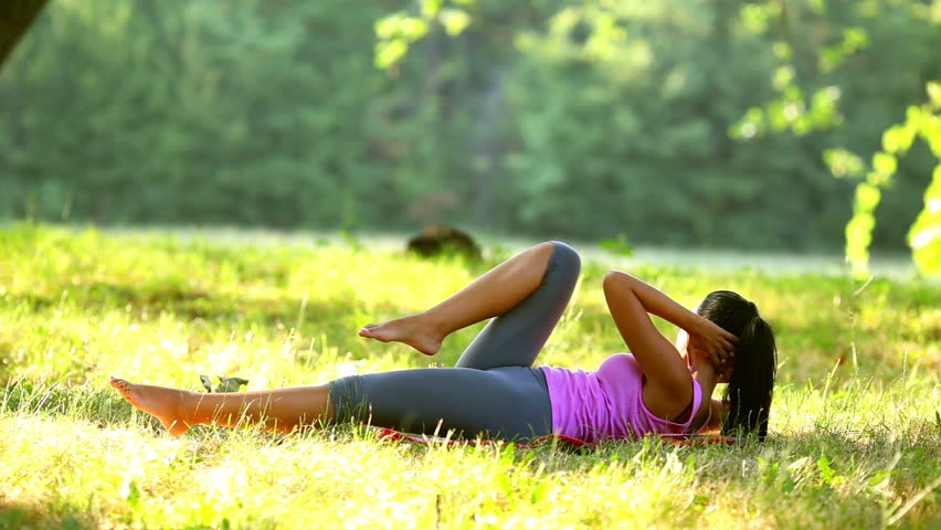 Woman exercising in park on beautiful day.