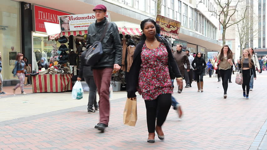 BIRMINGHAM, UK - APRIL 19: People visit shopping street on April 19, 2013 in Birmingham, UK. Birmingham metropolitan area is the 2rd most populous in the UK with 3.7 million people.