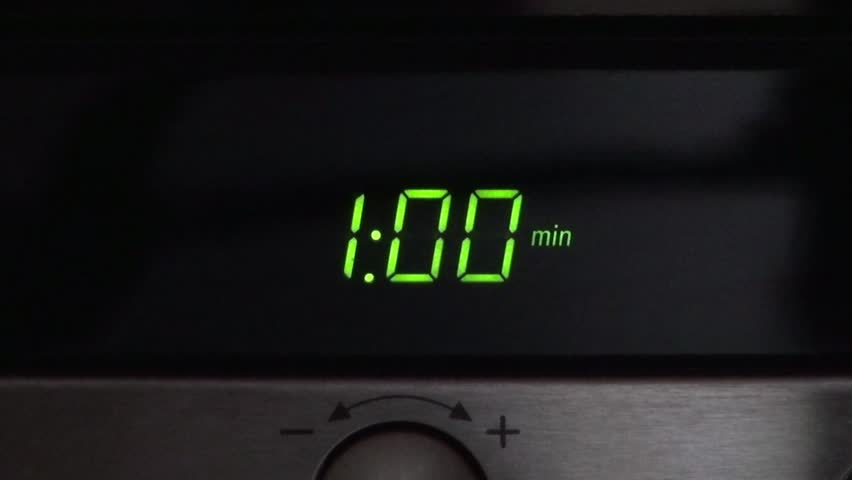 digital clock of microwave oven countdown 60 seconds