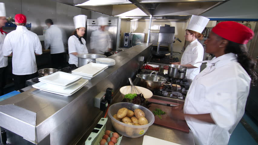 Time lapse clip of a busy team of chefs working hard and for Kitchen work