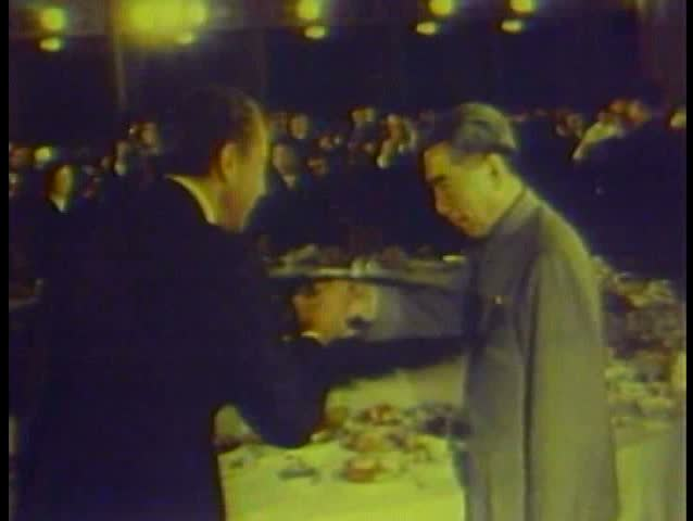 1980s - Richard Nixon and Henry Kissinger shake the hand of Chairman Mao in China.