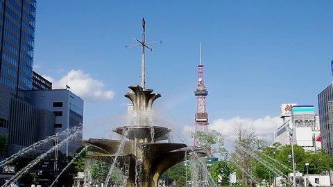 SAPPORO, JAPAN - MAY. 31 : The fountain and Sapporo TV Tower on May 31, 2013 in Sapporo, Hokkaido, japan.The Tower and fountain are located at Sapporo Odori Park.