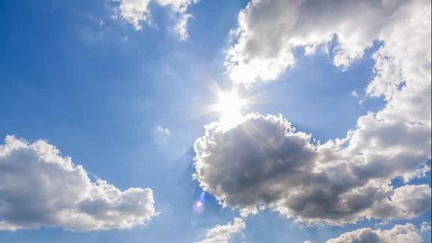 summer sky time lapse, sun shining and moving clouds,  airplane passing by